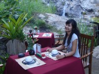 Romantic tables next to the waterfall