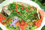 Steamed river fish in soy sauce